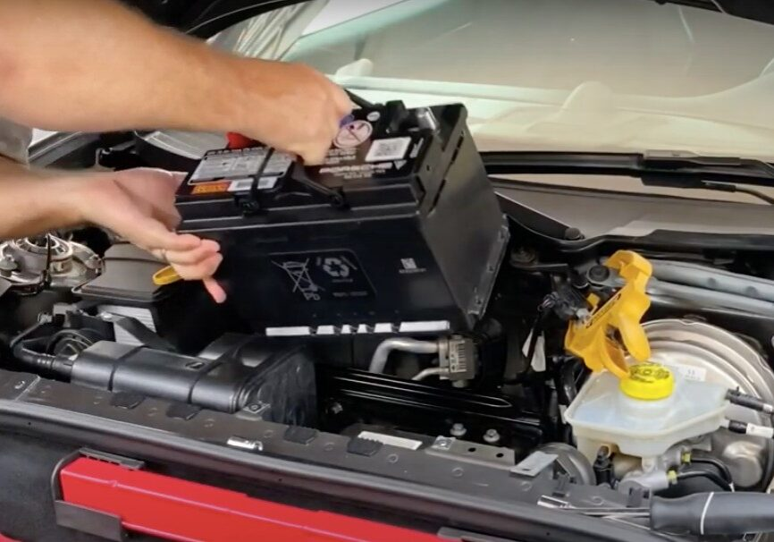 Mobile mechanic changing battery at customer location in Santa Ana, California.